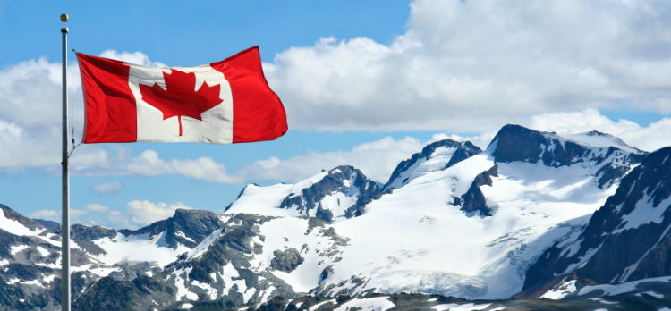 Challenging ski-slopes with the Canada flag in front of them